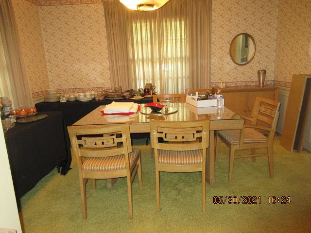 Dining room with table on green carpet