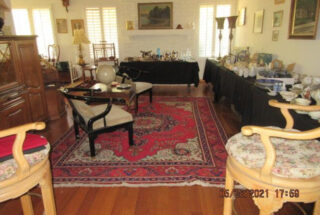 Living Room with items on table for sale