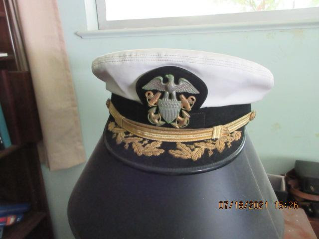 Navy officer's had on table